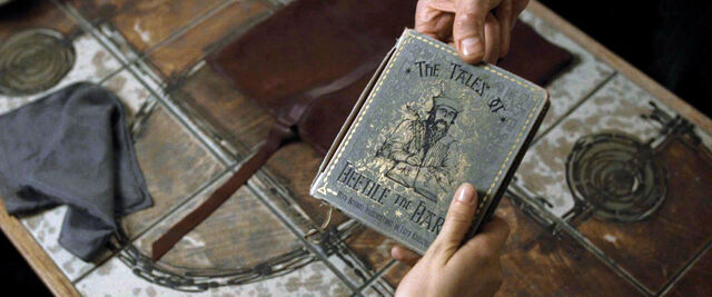 File:DH1 Scrimgeour passing The Tales of Beedle the Bard book to Hermione Granger.jpg
