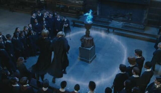 File:Fred and George jumping over Dumbledore's Age line.jpg