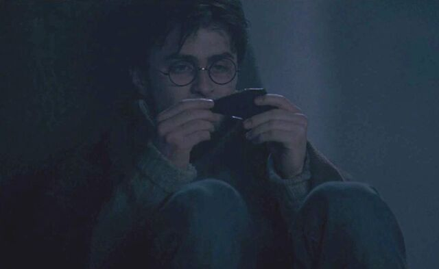 File:Harry Potter examining a shard of the Two-way Mirror given by Sirius Black.jpg