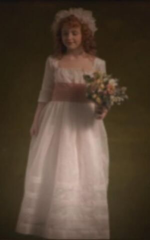 File:Girl with flowers.jpg