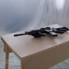 Desk with a assault rifle on it