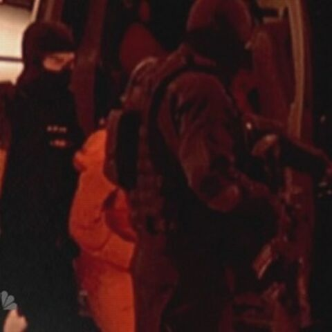 A hooded female fugitive being let out with Matt in front of her