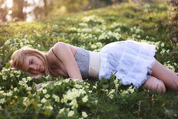 Beauty-blonde-flowers-girl-grass-lay-Favim.com-94880 large