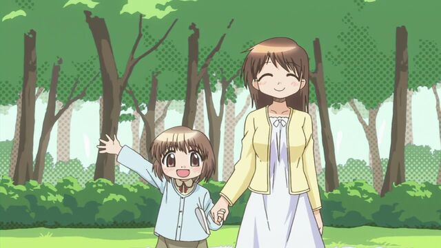 File:Girl and mother at shrine.jpg