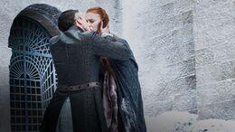 Petyr besa a Sansa HBO.jpg