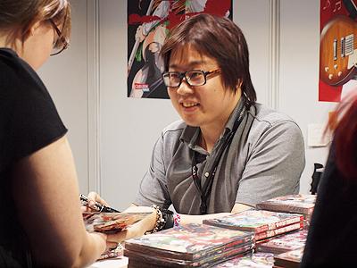 File:Shouji Sato signing.jpg