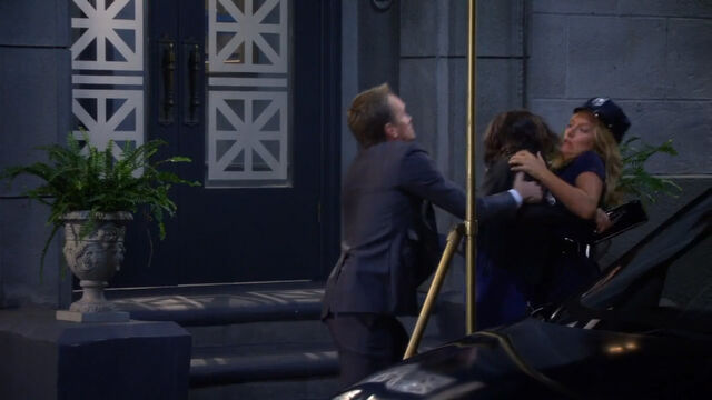 File:Barney interferes Robin and Quinn's fight.jpg