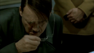 Hitler takes off glasses