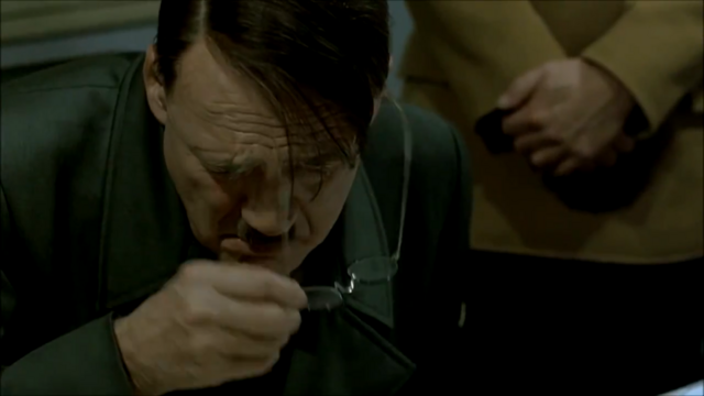 File:Hitler takes off glasses.png