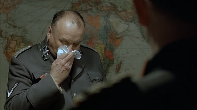 File:Bormann covers with a Handkerchief.png