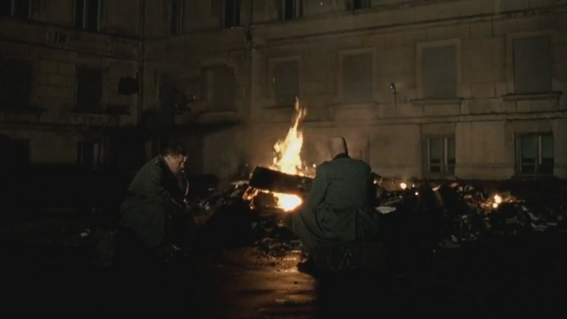 File:Schenck and Müller by the bonfire.png