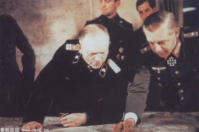 File:Walther Wenck points at a map and Heinz Guderian looks.jpg