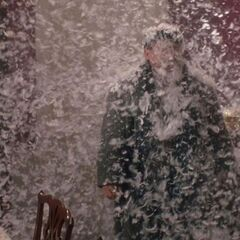 Harry is blown with feathers by a fan from <i>Home Alone</i>