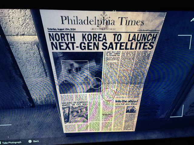 File:Image taken from an in-game safe house. (Notice the sub-article at the lower-left mentioning Kim Jong Un.)