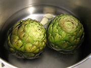 Artichokes being cooked