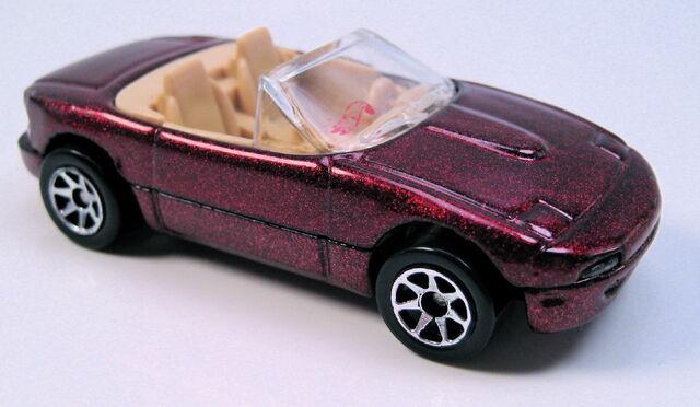 File:Mazda miata mx5 burgundy met tan int 7sp mal base.JPG