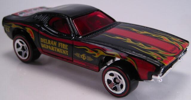 File:Dixie Challenger blakc flames walmart redline 5sp wheels 2011.JPG