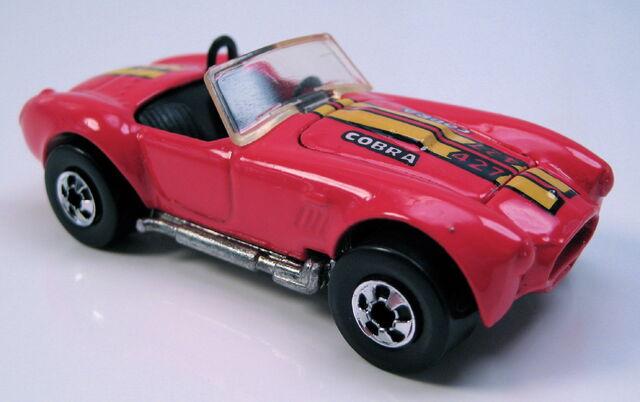 File:Classic cobra red metal malaysia base BW.JPG