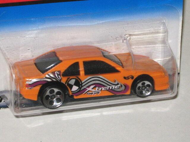 File:Orange T-STOCKER 5Dot.jpg
