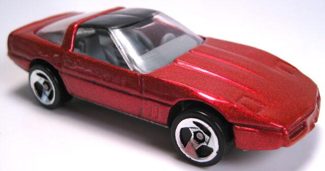 File:80s corvette orange pearl 3sp mal base 1996.JPG