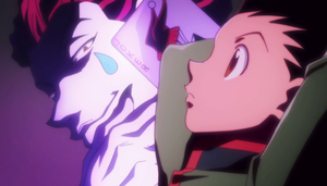 Gon thinking about how to steal Hisoka's badge