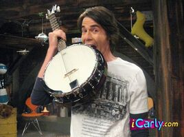 Freddie bet Spencer he couldn't eat his whole banjo. Spencer lost the bet!