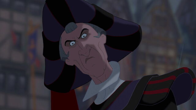 File:Frollo looking angrily (madly) upon Quasimodo.jpeg
