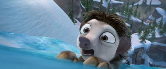 File:Louis sliding down frozen waterfall.JPG