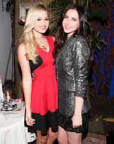 OLIVIA HOLT at Nylon Magazine Party in Los Angeles red black dress