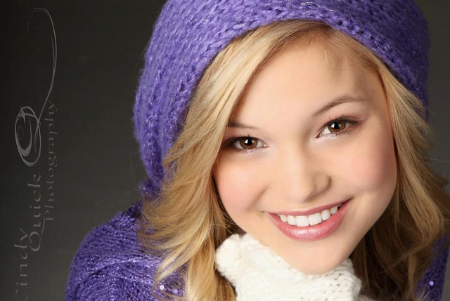 File:Olivia Wearing Purple Hat.png