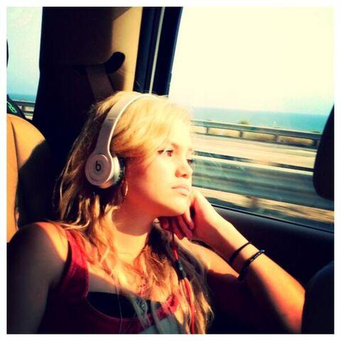 File:Olivia Wearing Beats.jpg
