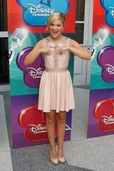 Olivia Pink Dress and the Heart Sign