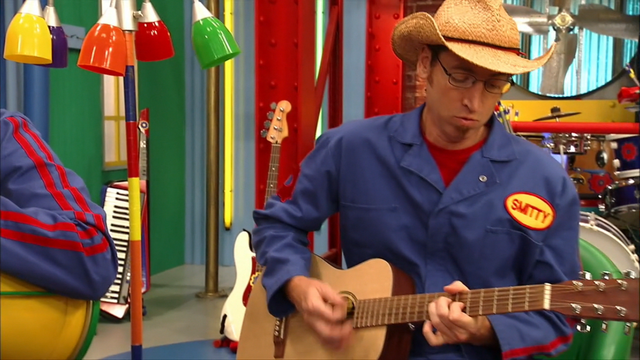 File:S3e24 Smitty playing instrument.png