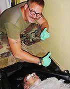 140px-AbuGhraibScandalGraner55-1-
