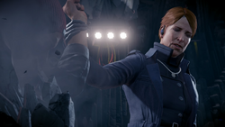 Augustine grabs Delsin's wrist during their confrontation in The Test mission