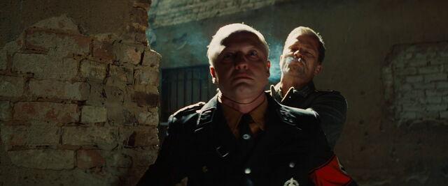 File:Hugo Stiglitz strangles Gestapo officer.jpg