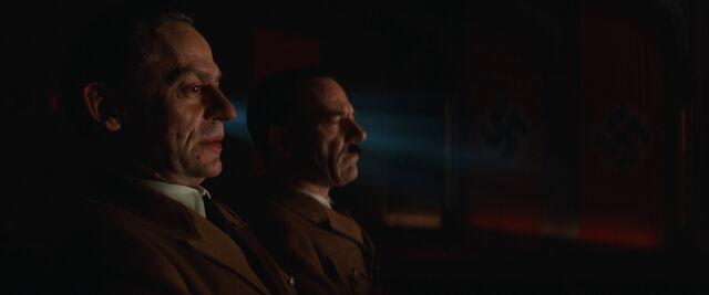 File:Goebbels and Hitler look at the film.jpg
