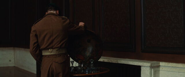 File:Archie Hicox looks inside the bar globe.jpg