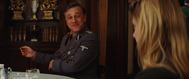 File:Hans Landa wipes restaurant table.jpg
