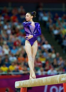 Kyla-ross-and-team-usa-adidas-royal-blue-star-design-leotard-gallery