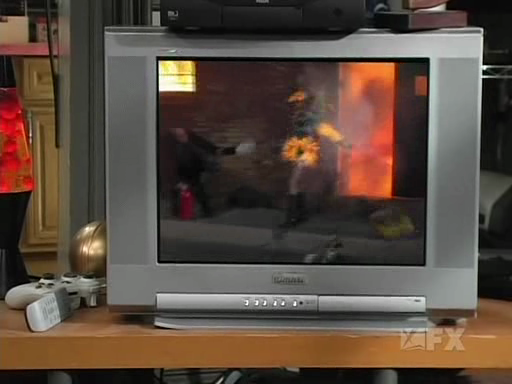 File:Frank Sets Sweet Dee on Fire.png