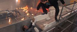 Licence to Kill - Dario tries to kill Bond on the conveyor