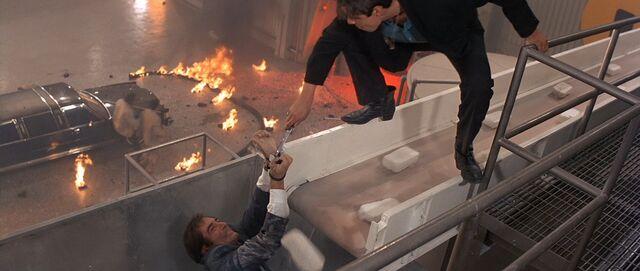 File:Licence to Kill - Dario tries to kill Bond on the conveyor.jpg