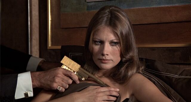 File:TMWTGG - Scaramanga, Miss Anders and the Golden Gun.jpg