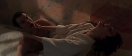 Xenia Onatopp crushes Bond at the pool (GoldenEye)