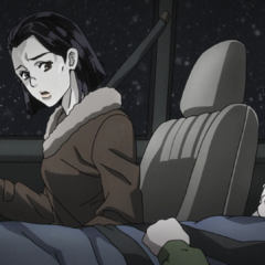 Tomoko desperately driving a young and gravely ill Josuke to the hospital.
