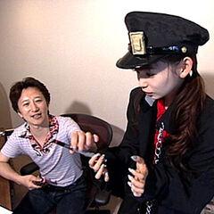 Shoko interviewing Araki while cosplaying as <a href=