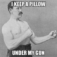 Overly Manly Man Pillow Under Gun