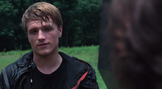 Peeta talking to Katniss