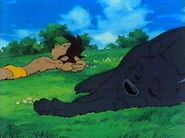 Mowgli and Bagheera Laying in the Meadow